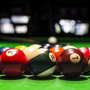 Billiard Balls. A Vintage style photo from a billiard balls in a pool table. Noise added for a film effect ** Note: Shallow depth of field